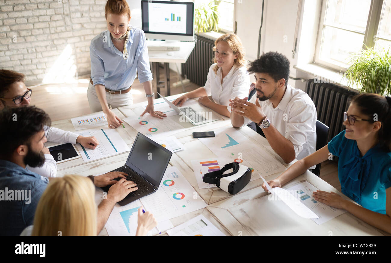 Happy creative team in office. Business, startup, design, people and teamwork concept - Stock Image
