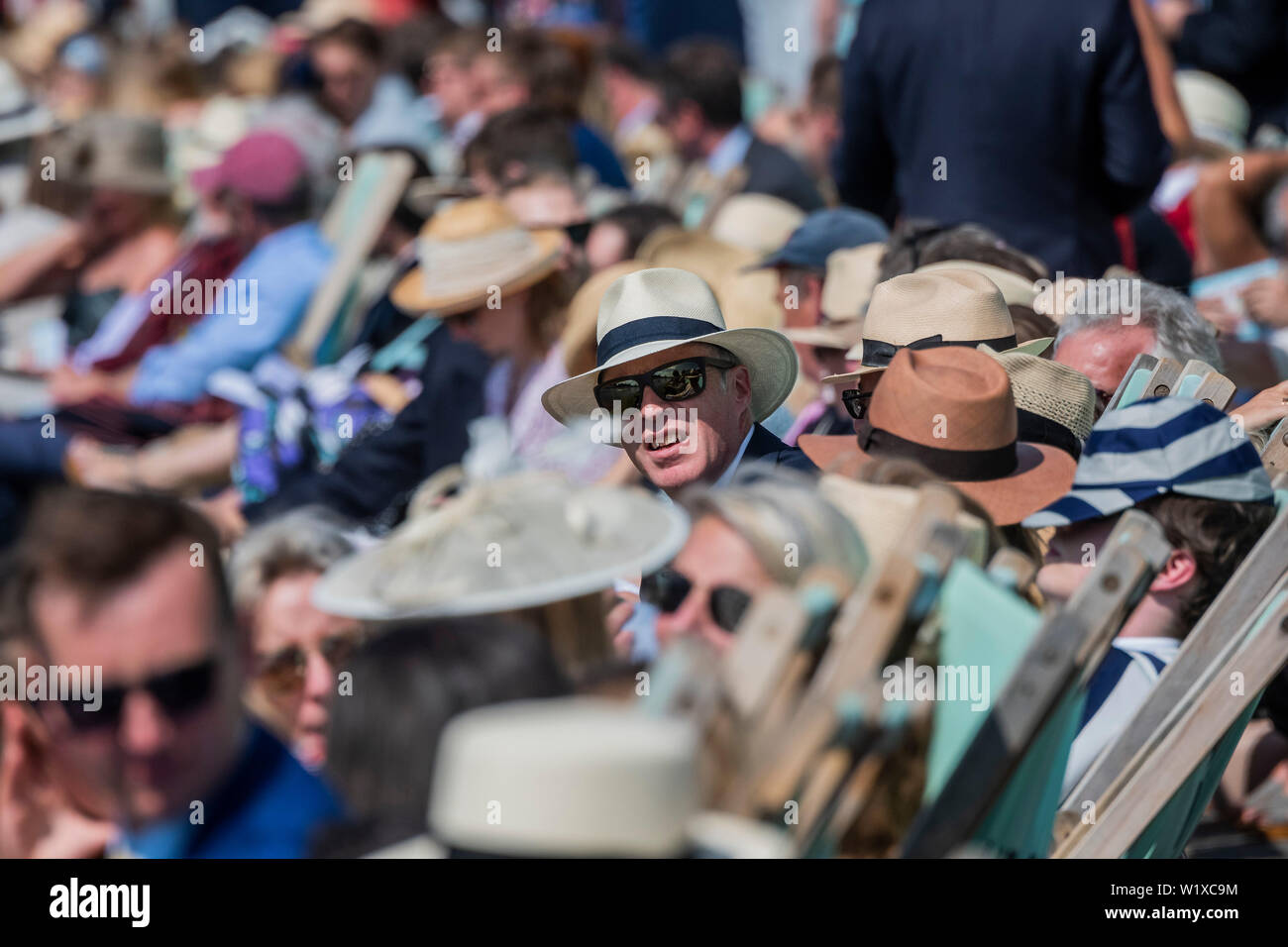 Henley-on-Thames, UK. 3rd July 2019. Spectators relax in deckchairs along the river bank - Rowing at the 2019 Henley Royal Regatta, Henley-on-Thames. Credit: Guy Bell/Alamy Live News - Stock Image