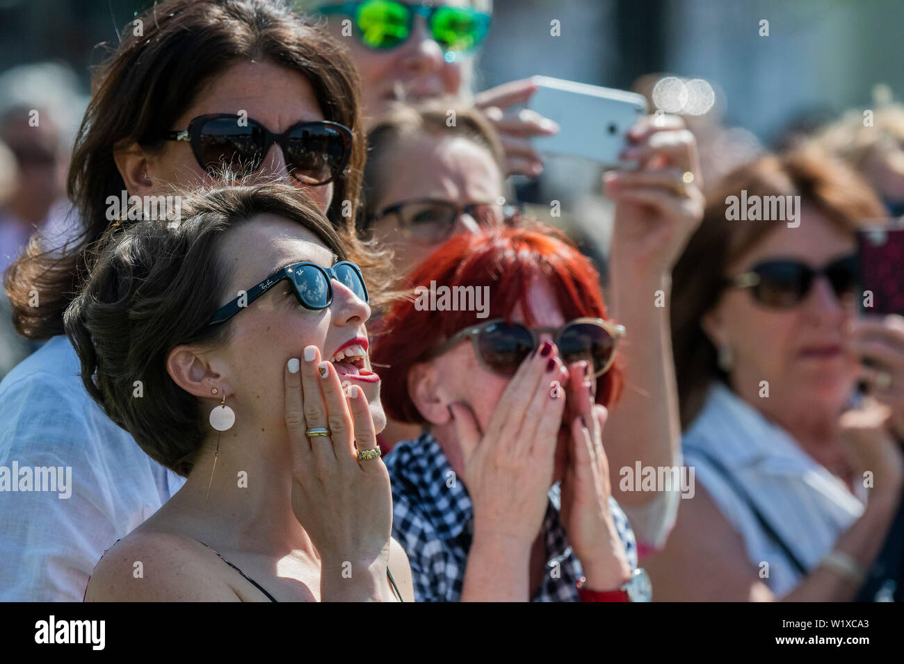 Henley-on-Thames, UK. 3rd July 2019. Speactators cheer on their crews from the river bank and from moored boats - Rowing at the 2019 Henley Royal Regatta, Henley-on-Thames. Credit: Guy Bell/Alamy Live News - Stock Image
