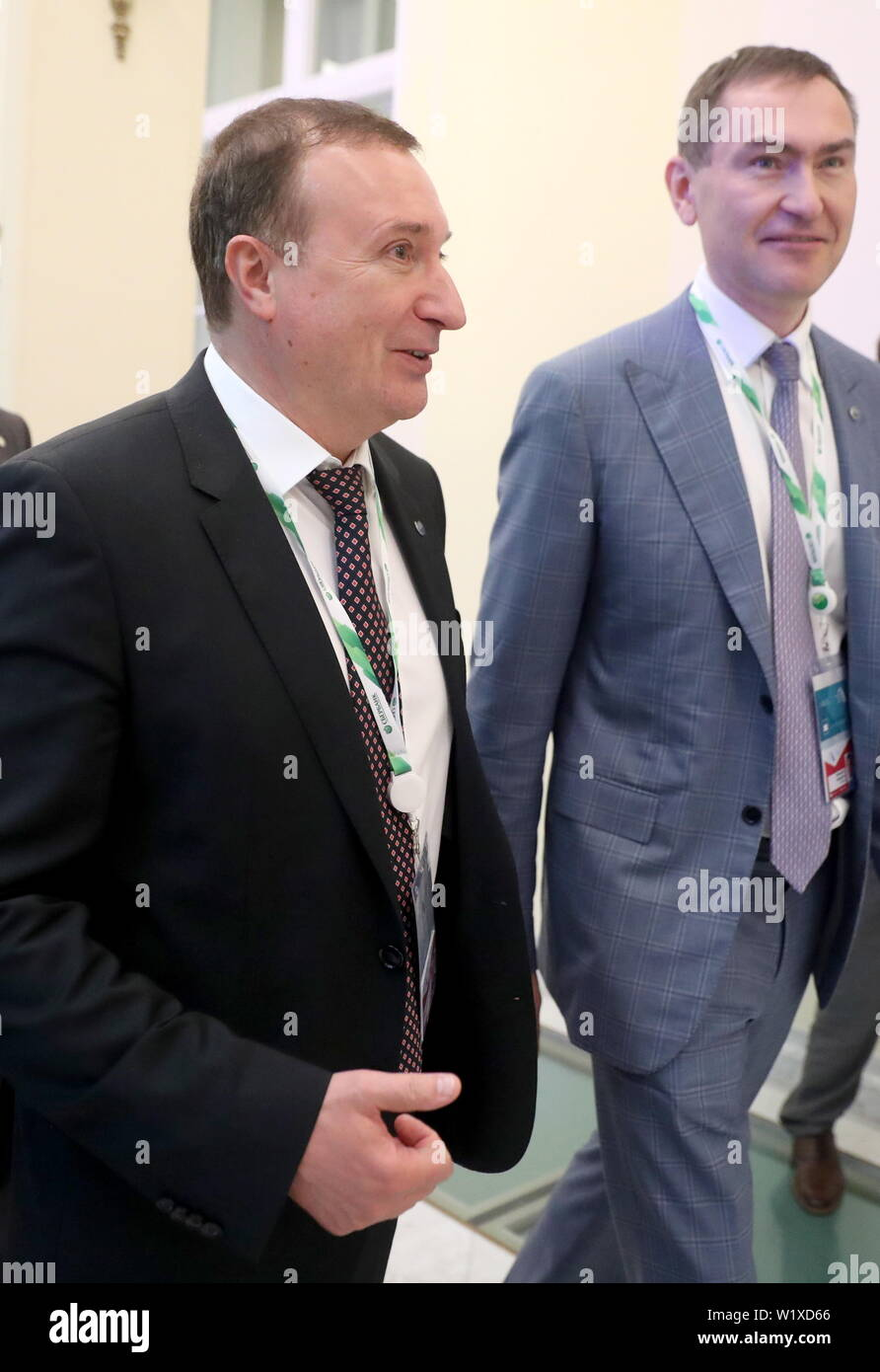 St Petersburg, Russia. 04th July, 2019. ST PETERSBURG, RUSSIA - JULY 4, 2019: Victor Ventimiglia Alonso (front), Head of the Sberbank Severo-Zapadny Branch, attends the 2019 International Financial Congress at Boris Yeltsin Presidential Library. Peter Kovalev/TASS Credit: ITAR-TASS News Agency/Alamy Live News - Stock Image
