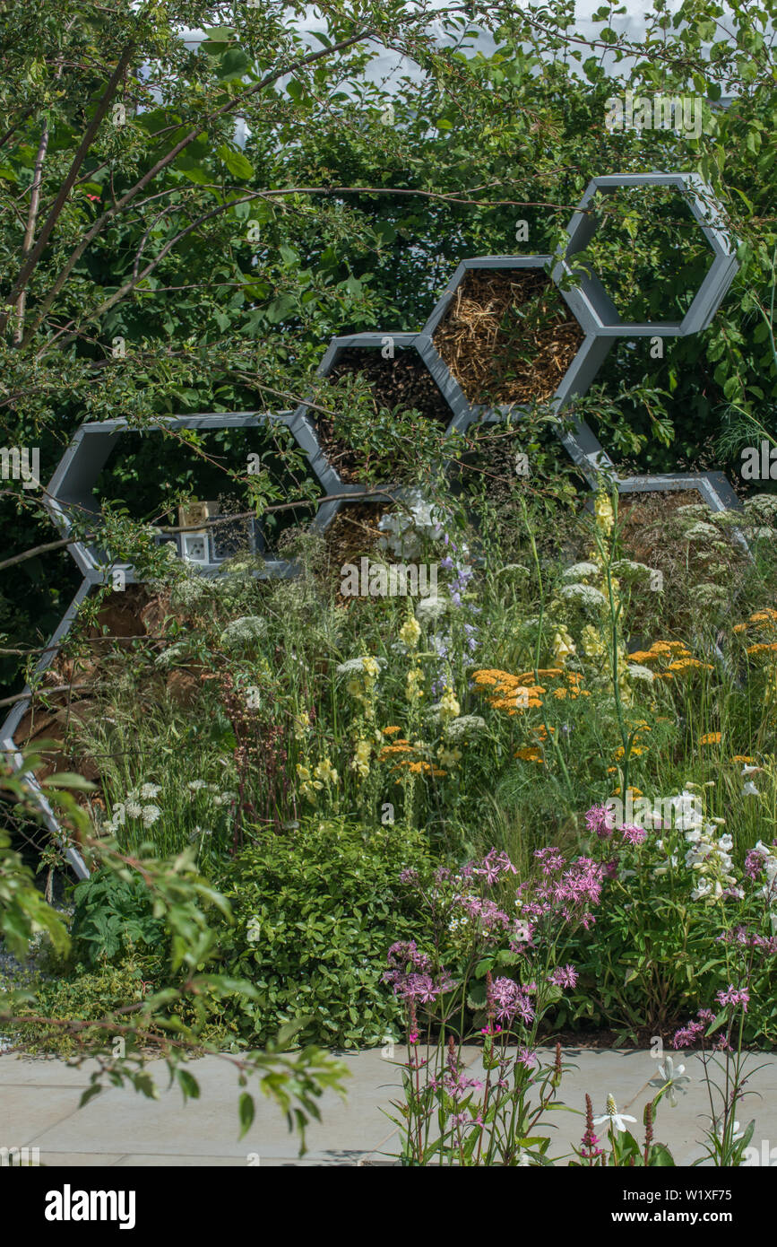 The Urban Pollinator Garden fuses design, function and wildlife-friendly values. It focuses on plants that encourage pollinators, specifically bees. - Stock Image