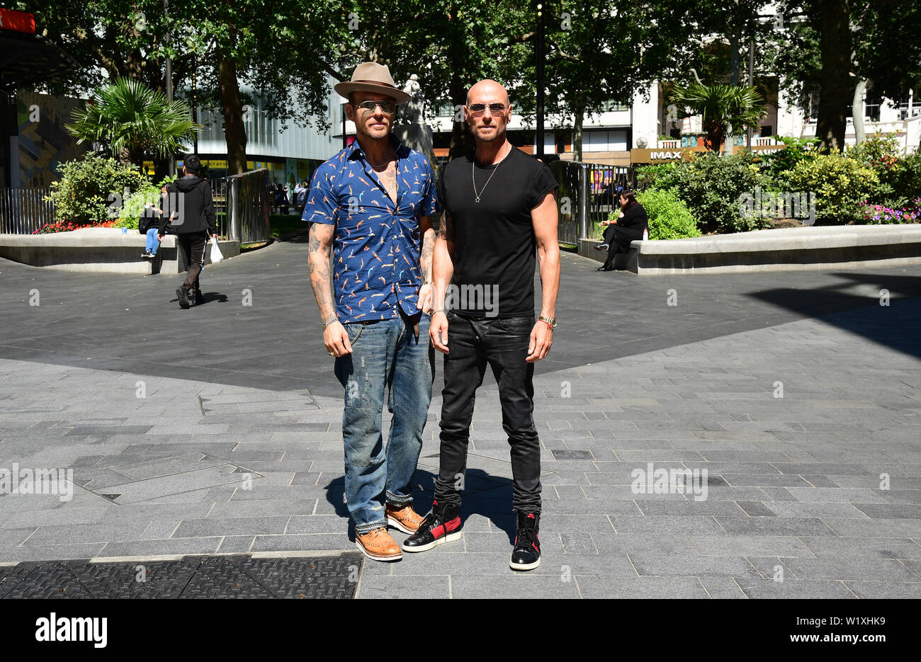 Matt and Luke Goss arrive to appear on Global Radio, to promote their upcoming show A Night in with the Bros, which airs on BBC4 on July 19. - Stock Image