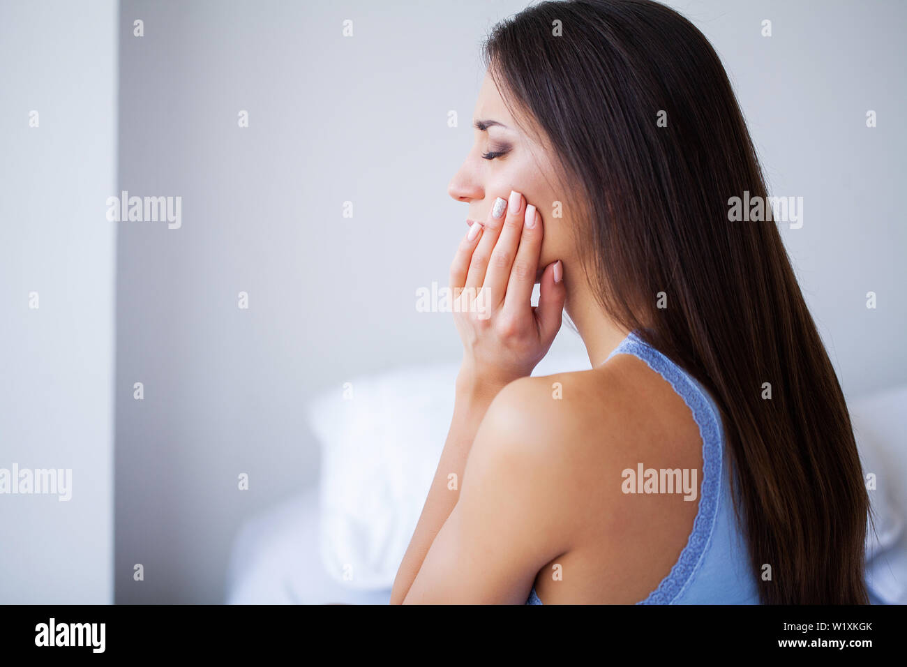 Tooth Pain. Dental care and toothache. Woman Feeling Tooth Pain. Closeup Of Beautiful Sad Girl Suffering From Strong Tooth Pain. Attractive Female - Stock Image