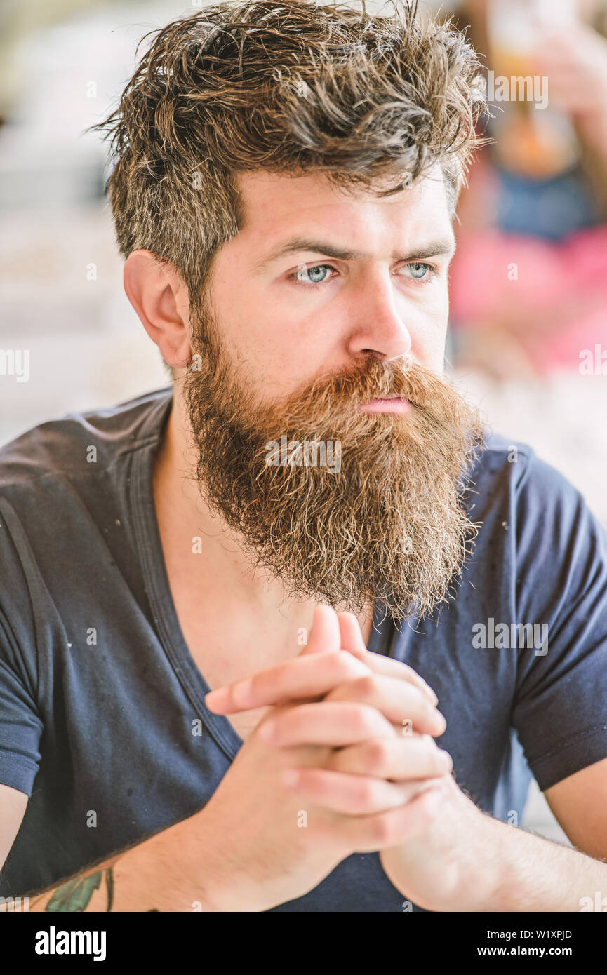 Bearded man concentrated face. Hipster with beard thoughtful expression. Thoughtful mood concept. Making important life choices. Making hard decision. Man with beard and mustache thoughtful troubled. - Stock Image
