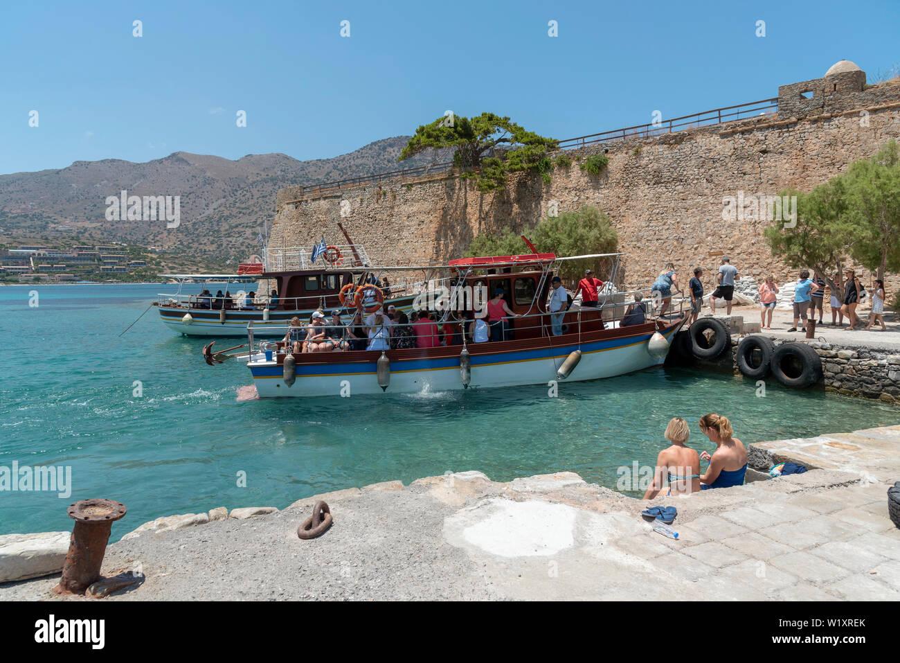 Spinalonga Island, Crete, Greece. June 2019.Small passenger ferry transporting tourists to Spinalonga a former Leper Colony. - Stock Image