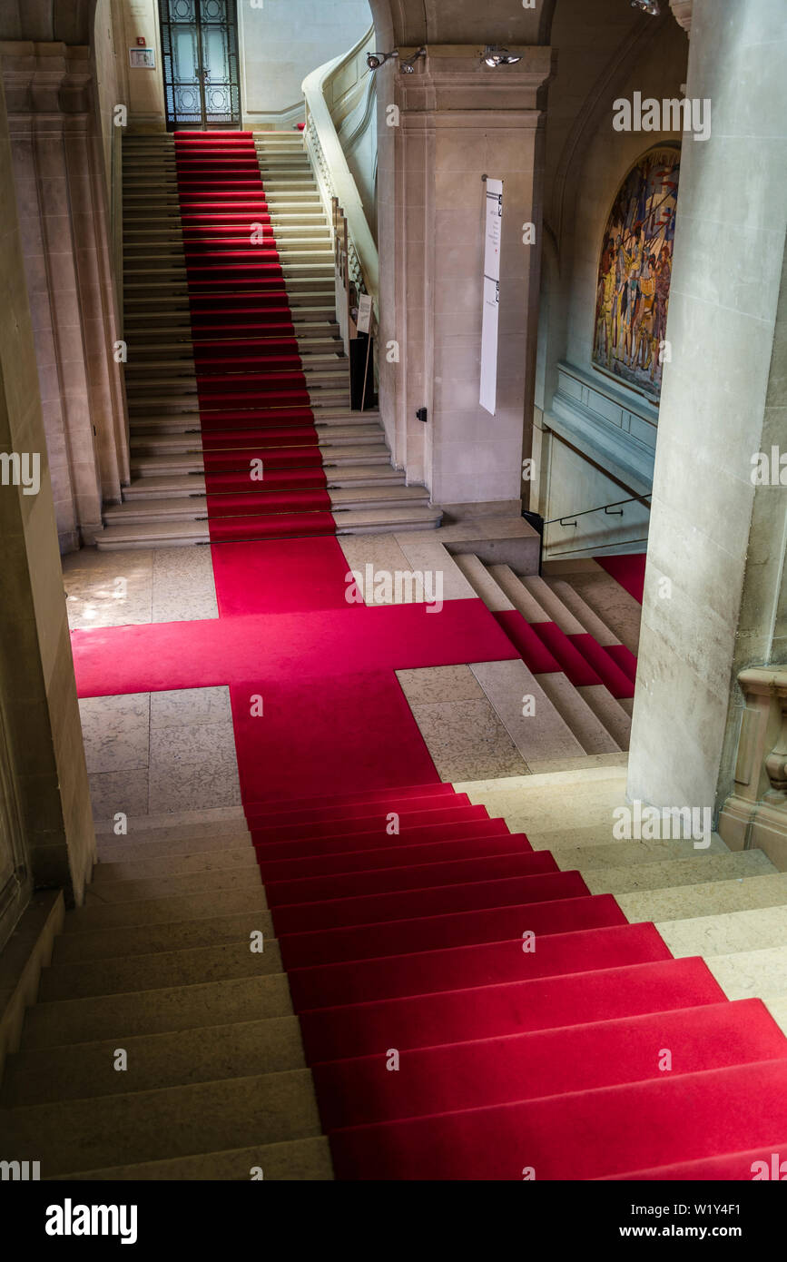 Interior with elegant stairs and red carpet, Art and history museum, the largest museum in the city, Geneva, Switzerland Stock Photo