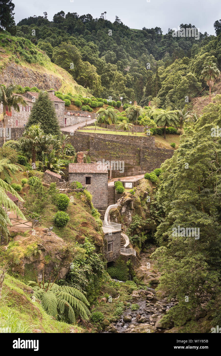 Fresh green color of the vegetation, which includes also generic plants. Nature park with a waterfall in Nordeste, Sao Miguel, Azores Islands, Portuga Stock Photo