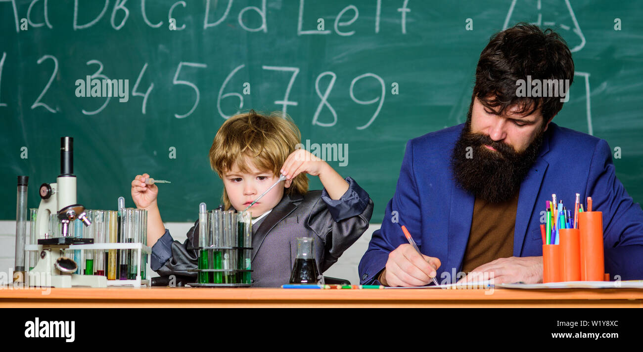 son and father at school  Formula  experiments in organic