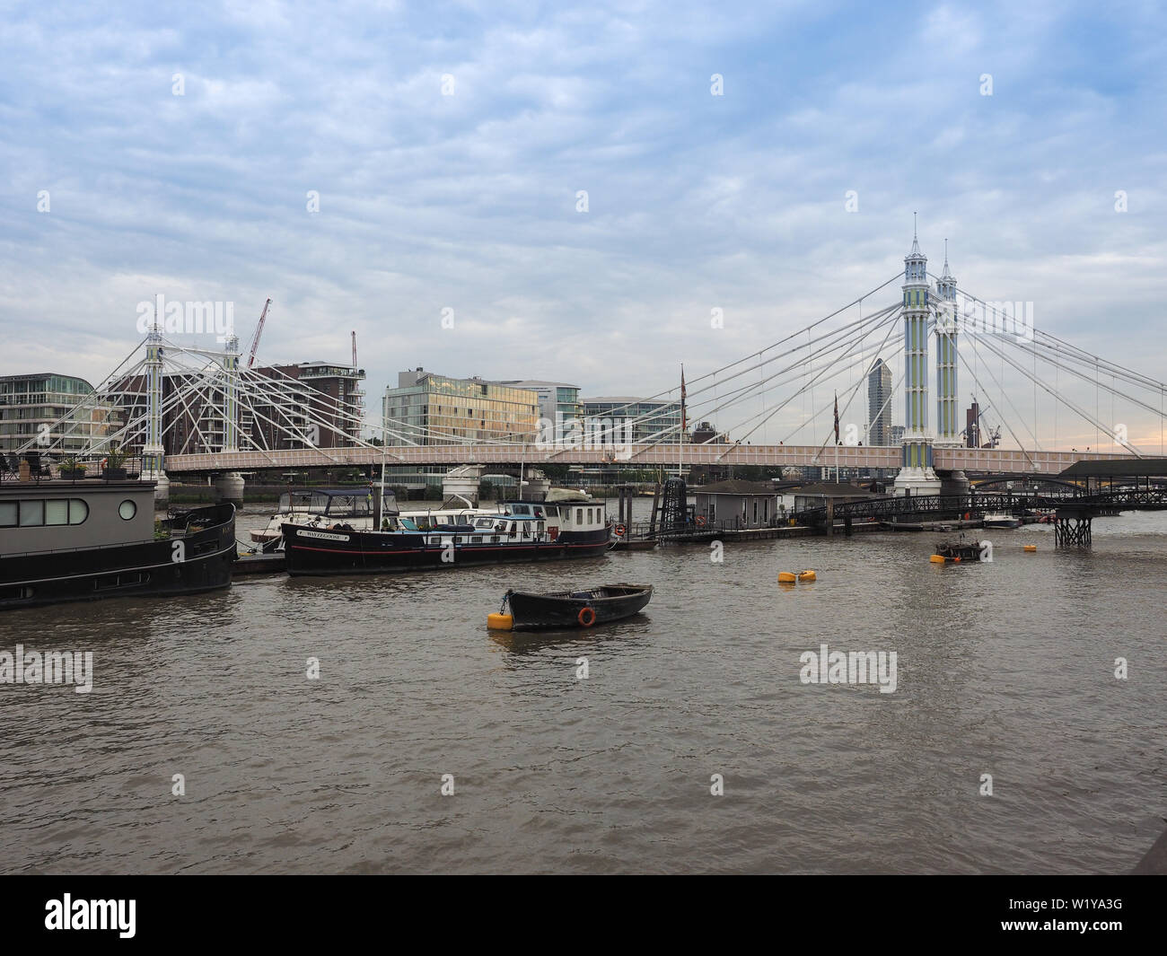 LONDON, UK - CIRCA JUNE 2019: Albert Bridge crossing River Thames - Stock Image
