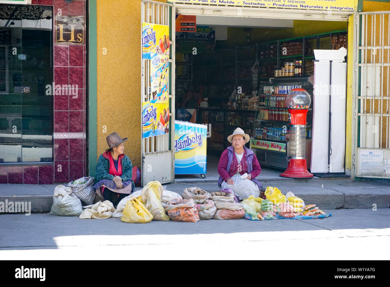 Huaraz, Ancash / Peru: 15 June 2016: indigent Indio farmer women sell their fruit and vegetables on the streets of Huaraz - Stock Image
