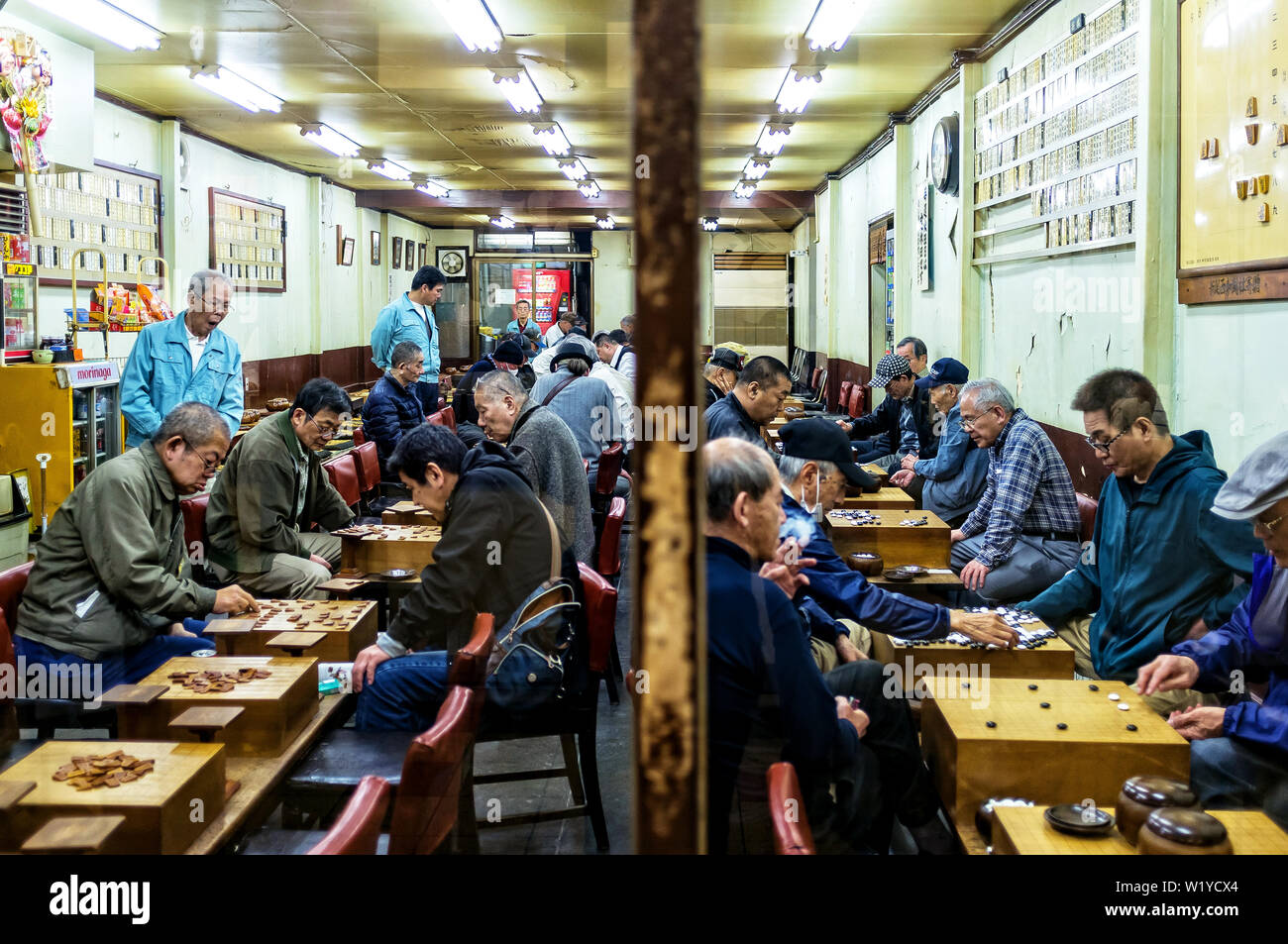 April 18, 2019: Japanese men playing a traditional Japanese game on a bar - Stock Image