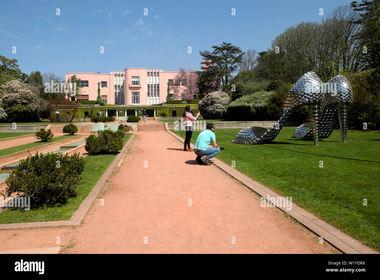 Tourists photographing 'Marilyn PA' by Joana Vasconcelos and art deco house at Serralves Museum in Porto Oporto Portugal Europe  KATHY DEWITT - Stock Image