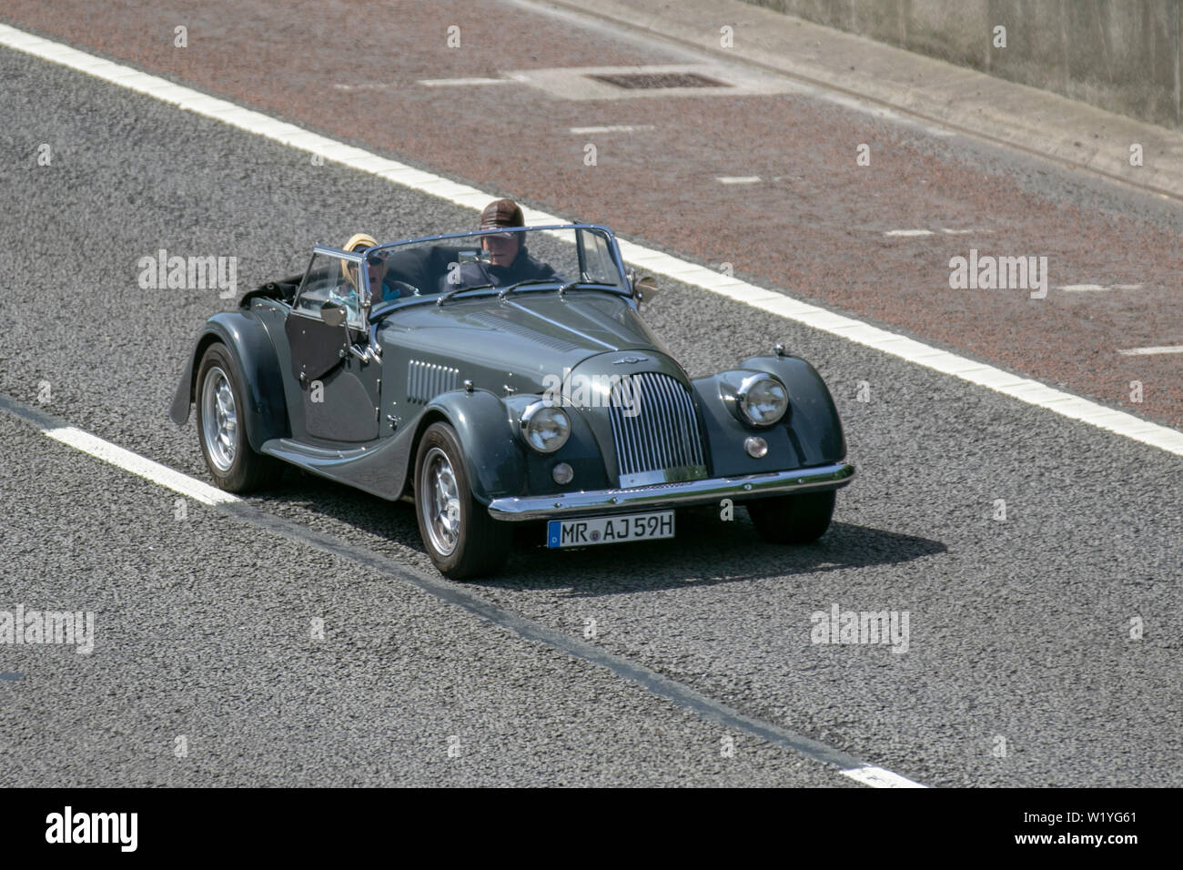 Vintage Grey Green Morgan Classic Two Seater Sports Car Uk Vehicular Traffic Transport Modern Saloon Cars North Bound On The 3 Lane M6 Motorway Highway Stock Photo Alamy