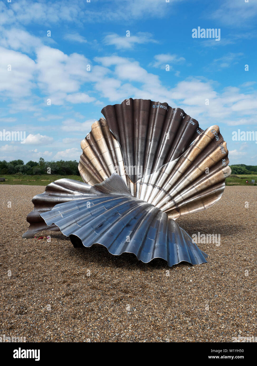 Scallop sculpture dedicated to Benjamin Britten by Maggi Hambling on the beach at Aldeburgh Suffolk England - Stock Image