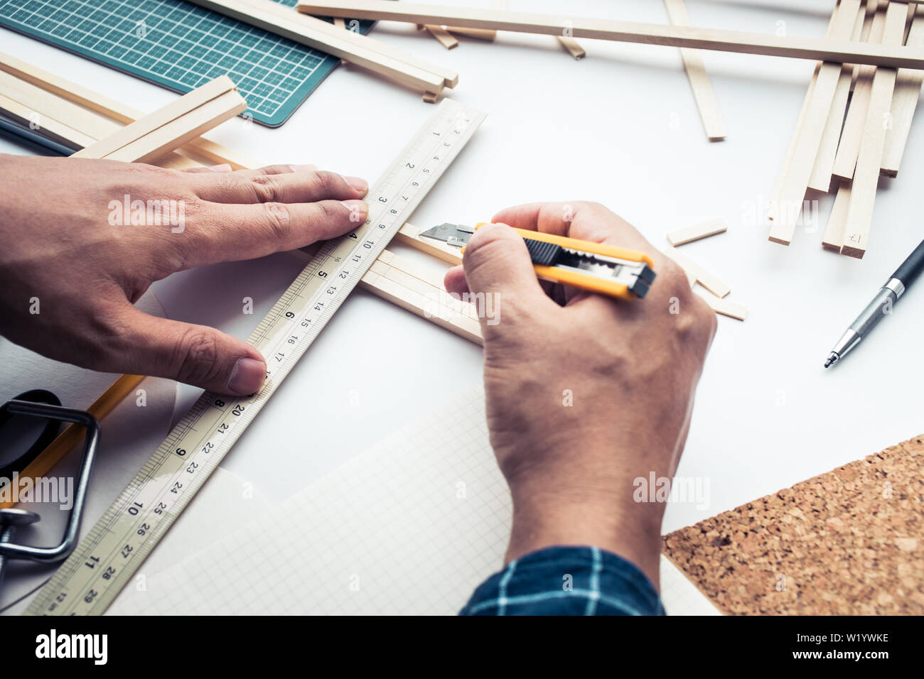 Male working on worktable with balsa wood material.Diy,design project,invention concept ideas Stock Photo