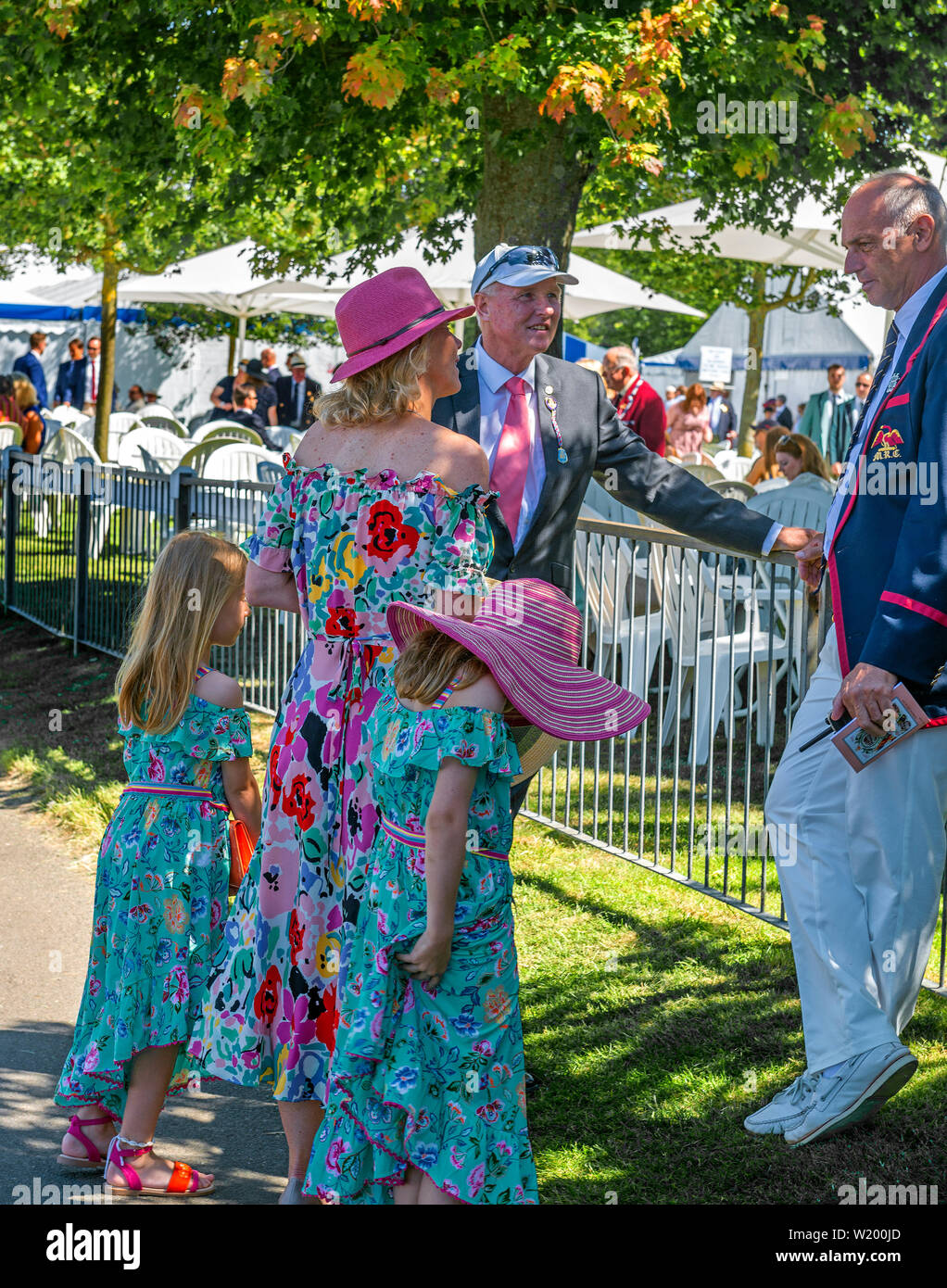 Henley on Thames, Berkshire, UK. 4th July, 2019. Henley Royal Regatta. Former Olympian and Henley Royal Regatta's chairman, Sir Steve  Redgrave .talks to collegue and friends outside the Stewards Enclosure  . Credit Gary Blake/Alamy Live - Stock Image