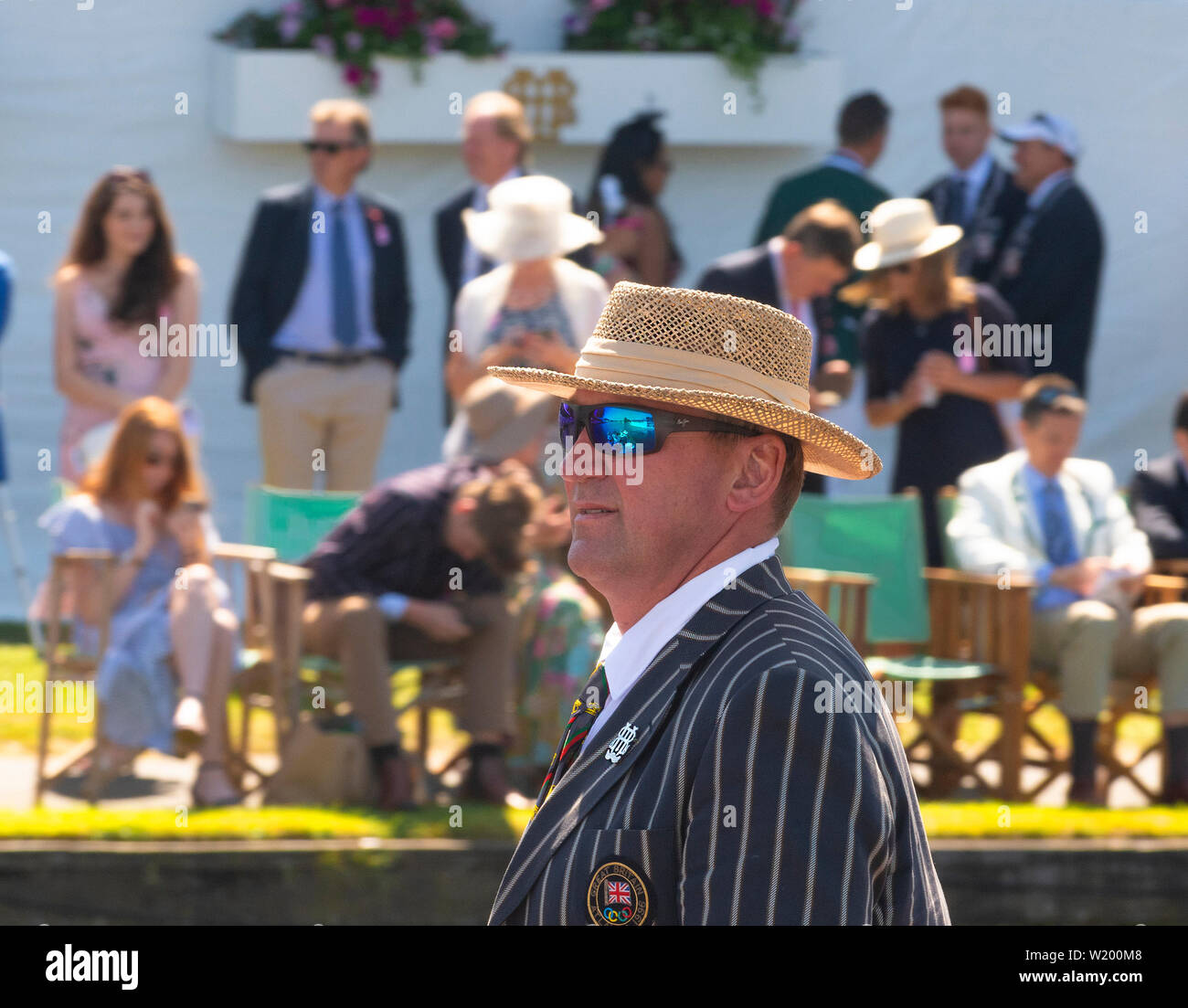 Henley on Thames, Berkshire, UK. 4th July, 2019. Henley Royal Regatta. Former Olympian and a  Henley Royal Regatta Umpire, Sir Matthew Pinsent ,standing in the umpires boat going past the spectators in the Stewards Enclosure to start the race. Credit Gary Blake/Alamy Live - Stock Image
