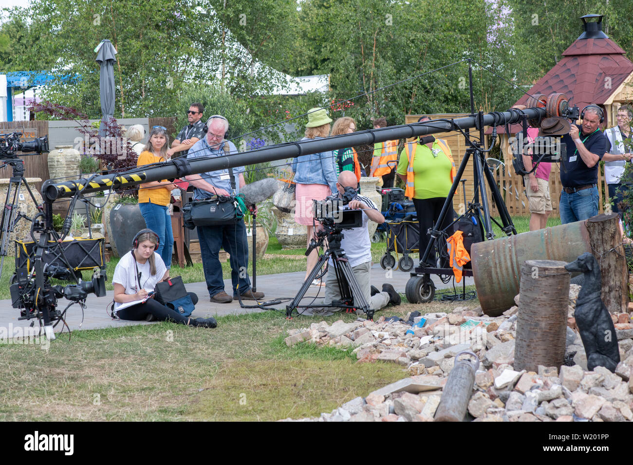BBC Gardeners world film crew outside the calm against chaos show garden at RHS Hampton Court flower show 2019. Hampton Court Palace, Surrey, England - Stock Image