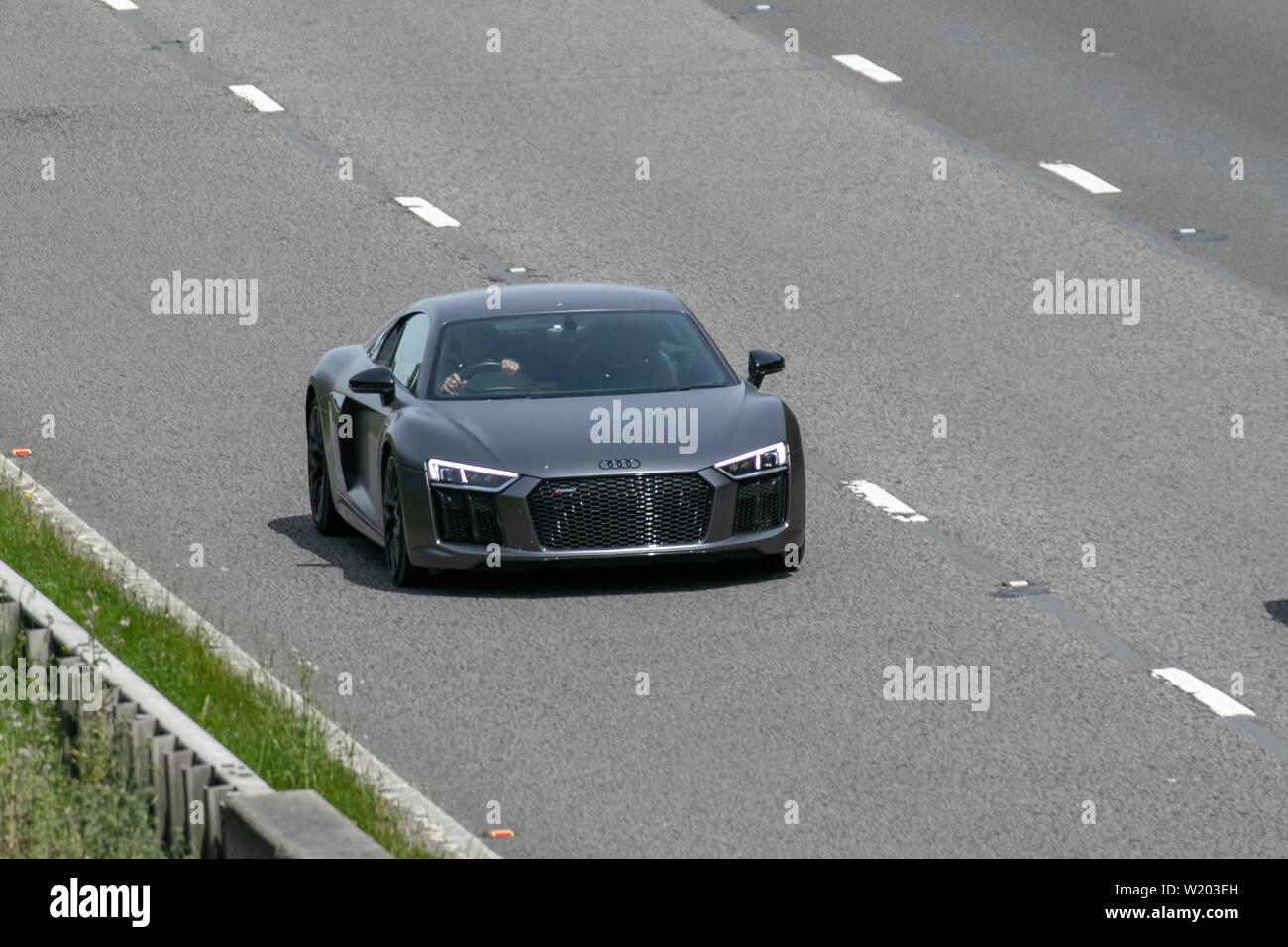 High-end Luxury Audi R8 Sports car;UK Vehicular traffic, transport, modern, saloon cars, north-bound on the 3 lane M6 motorway highway. - Stock Image