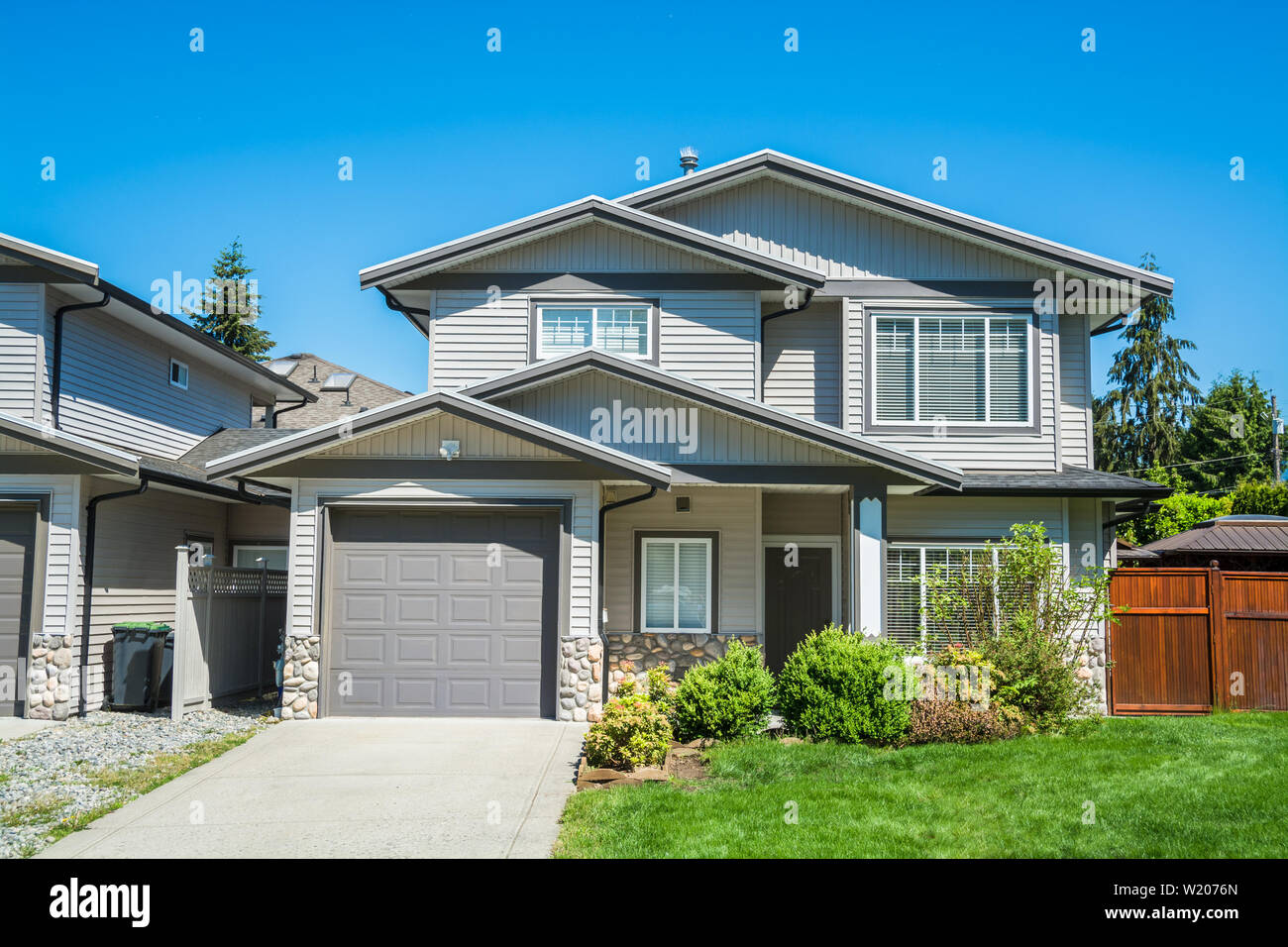 Brand new afordable family home, half duplex building. Stock Photo