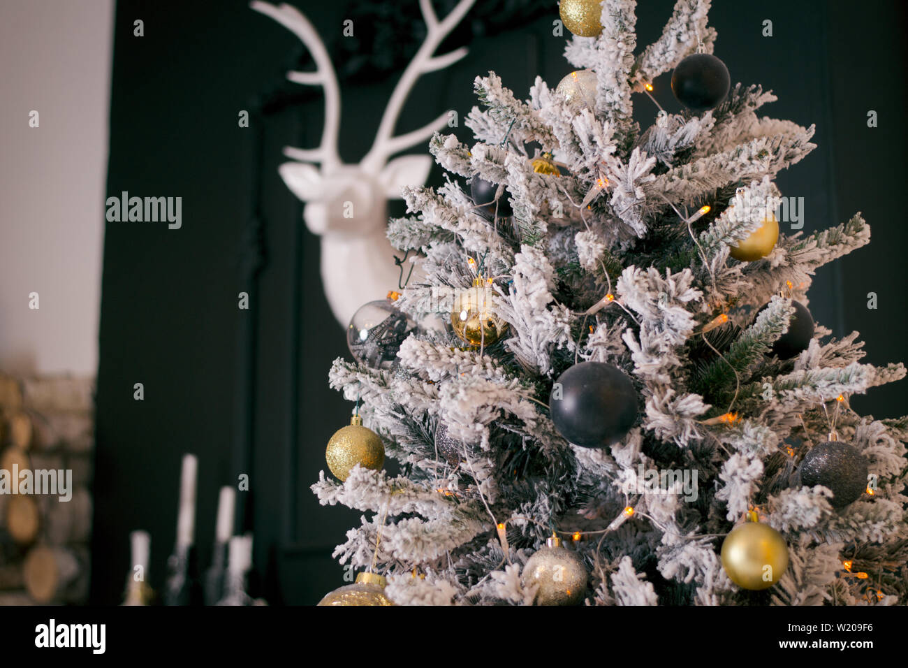 Dark Green Christmas Tree With White Artificial Snow On It Indoors Gothic Christmas Tree With Gold And Dark Blue Ornaments Dark Christmas Interior W Stock Photo Alamy
