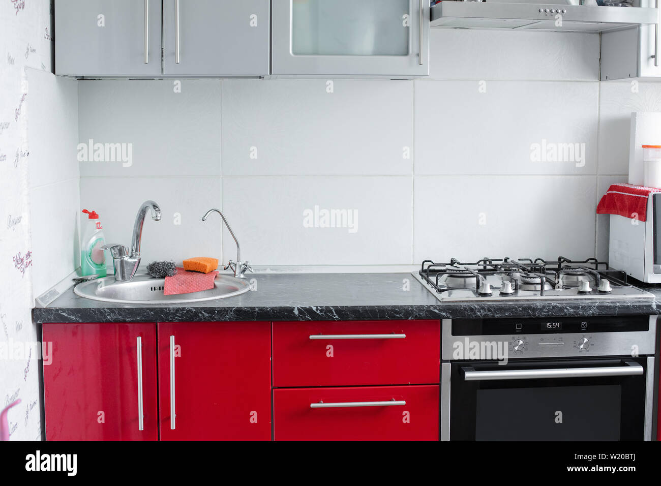 Beautiful modern clean red kitchen in small apartment full ...