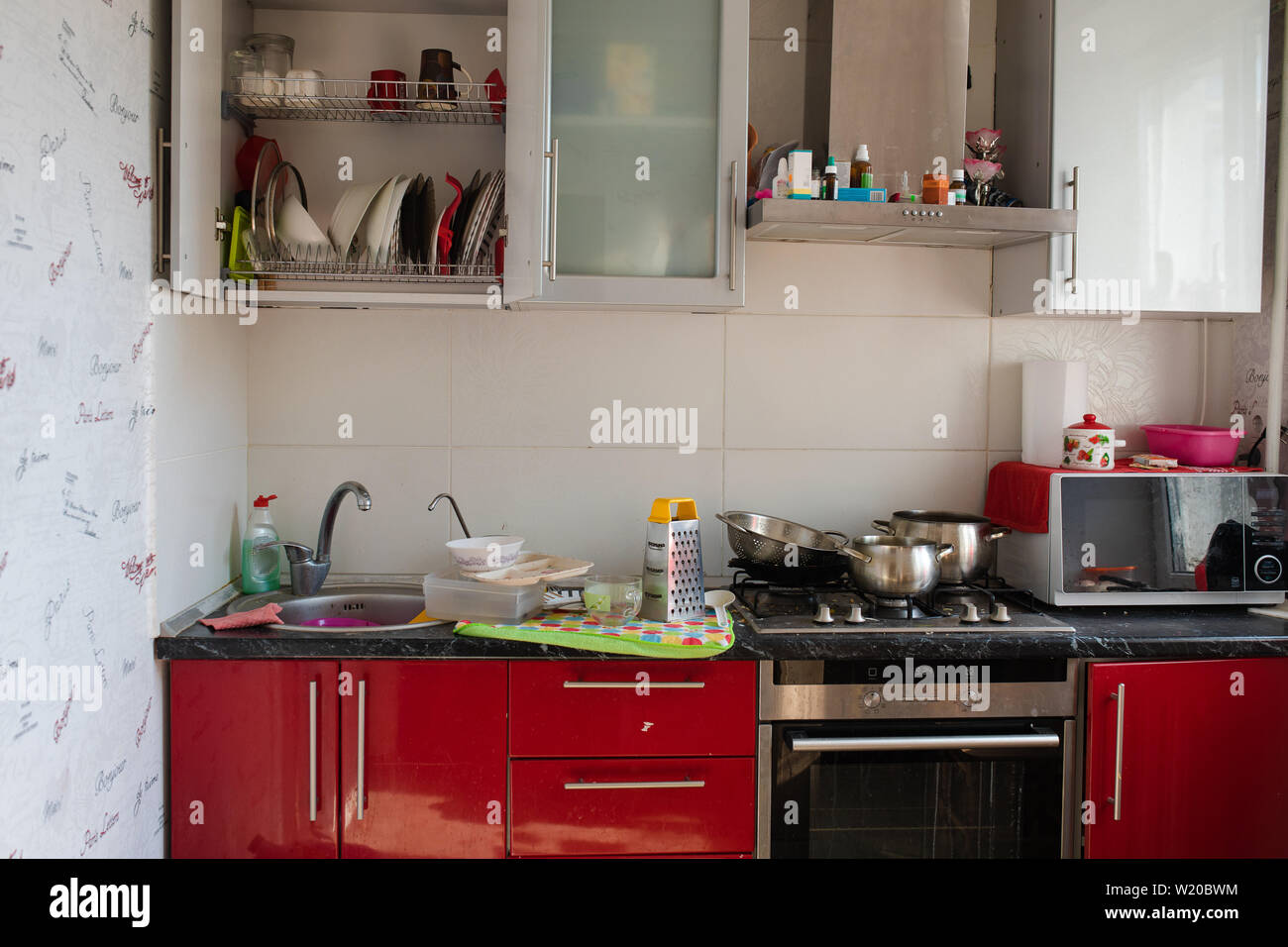 Typical Small Kitchen With Dirty Dishes And Clutter Full Shot Stock Photo Alamy
