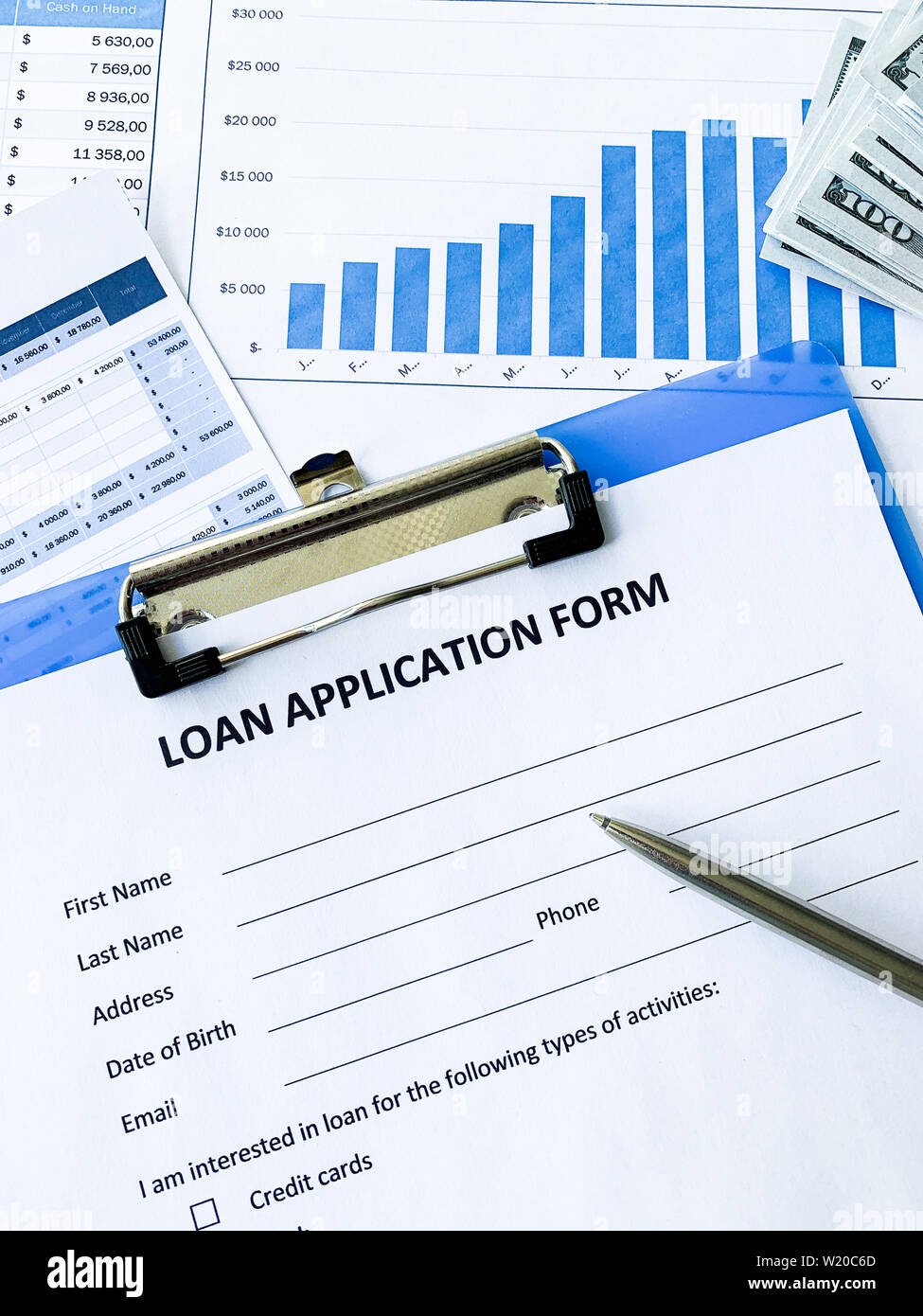 Loan application form document with graph on table Stock Photo