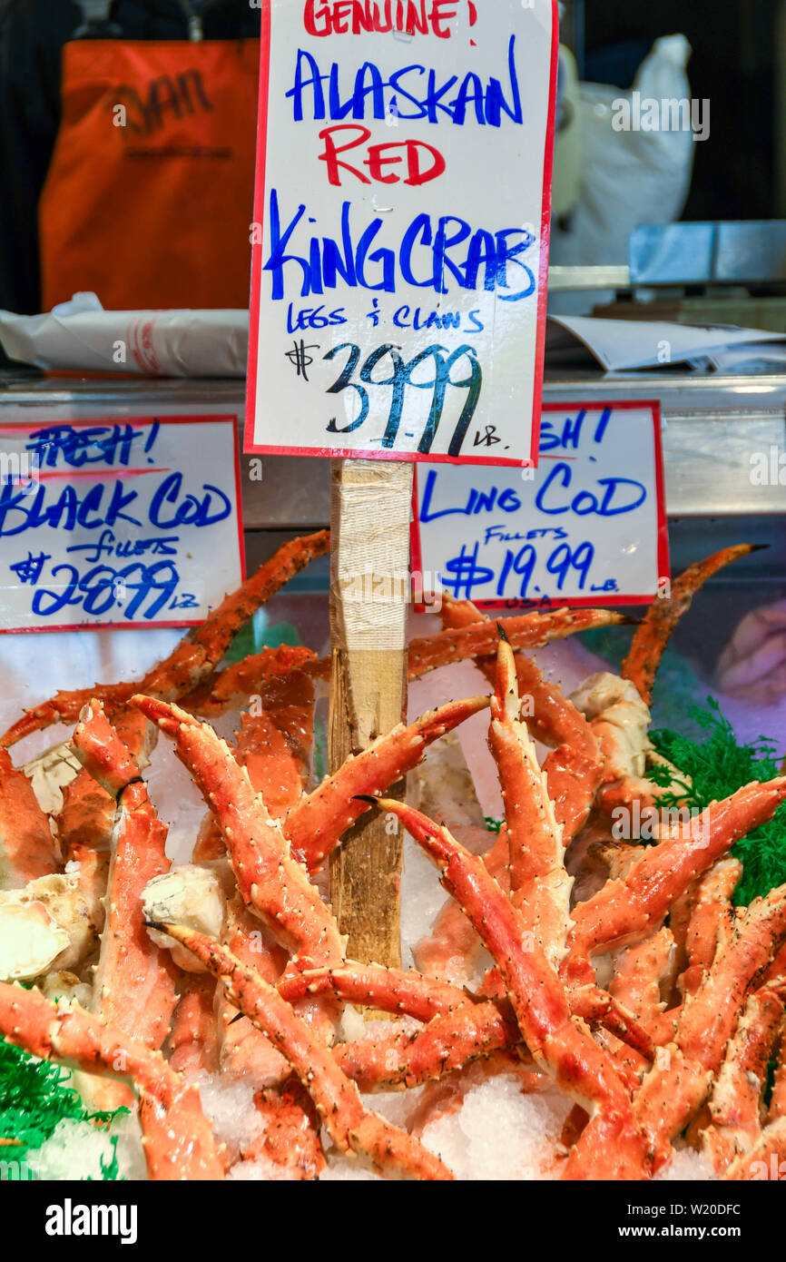 SEATTLE, WASHINGTON STATE, USA - JUNE 2018: Close up view of fresh King Crab legs on sale in Pike Place Market in Seattle city centre. - Stock Image