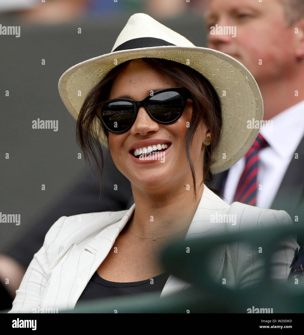 London, UK. 04th July, 2019. LONDON, ENGLAND - JULY 04: Meghan, Duchess of Sussex attends day four of the Wimbledon Tennis Championships at All England Lawn Tennis and Croquet Club on July 04, 2019 in London, England. People: Meghan, Duchess of Sussex Credit: Storms Media Group/Alamy Live News Stock Photo