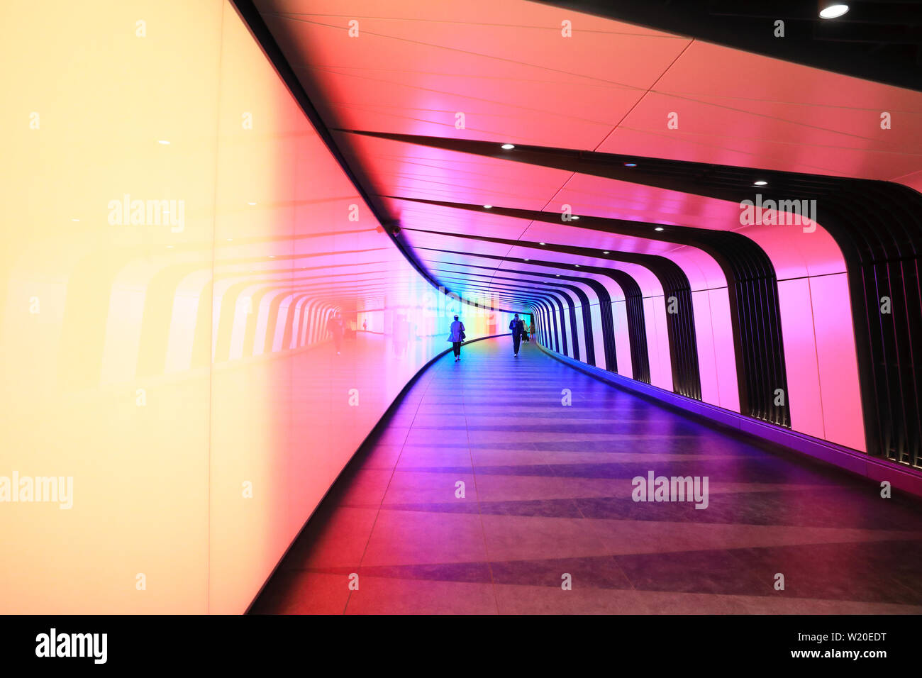 The multicoloured King's Cross Tunnel, between Kings Cross and St Pancras stations and towards Granary Square, in north London, UK Stock Photo