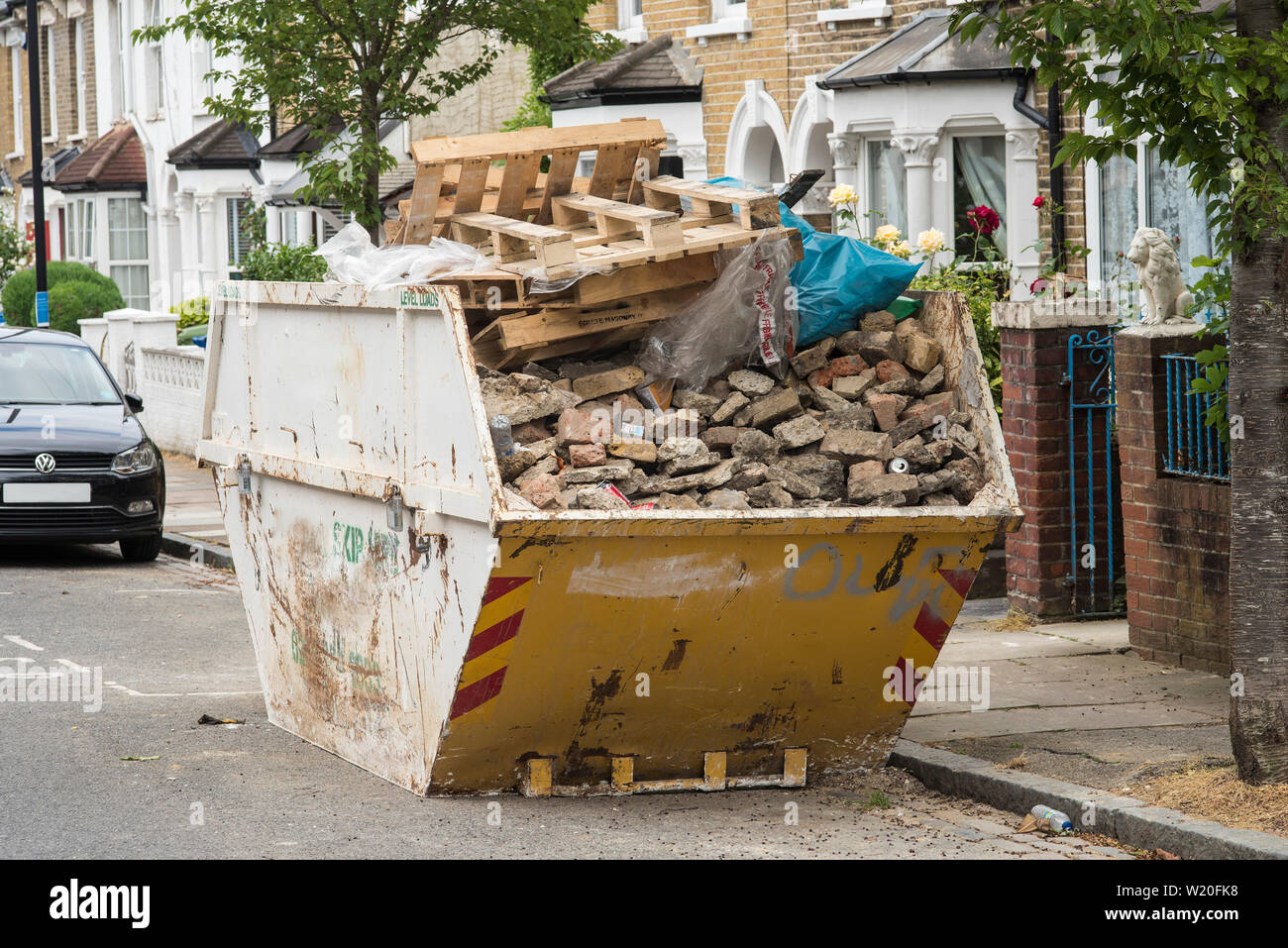 A skip of mixed construction / home renovation rubbish / waste likely destined for landfill, not recycling. De-branded. Stock Photo