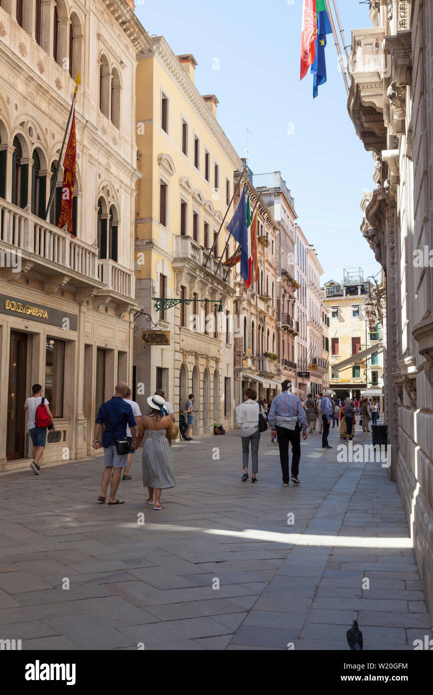 Calle Larga XXII Marzo, San Marco, Venice, Veneto, Italy one of the main shopping streets of Venice with leading brand stores early morning with touri - Stock Image