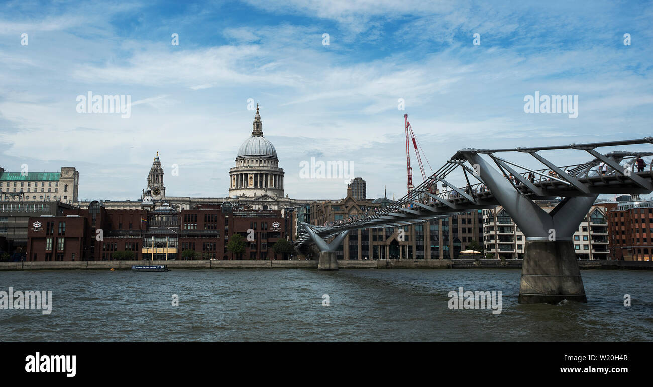 A View From In Front Of Tate Modern Gallery Of The Millennium Bridge Leading To St Paul S Cathedral And The Corporation Of London Building Stock Photo Alamy