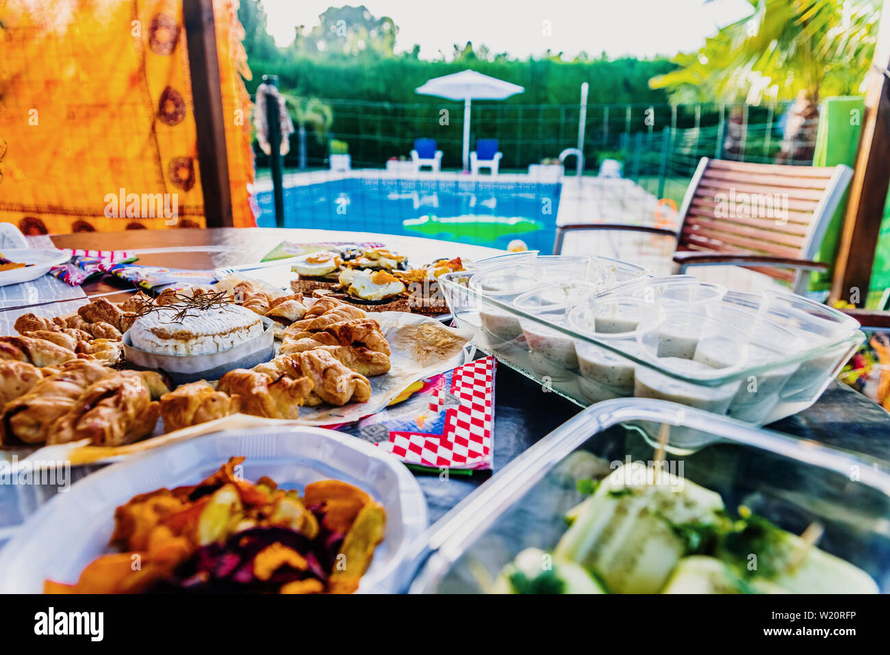 A copious snack served by the pool during the summer holidays. Stock Photo