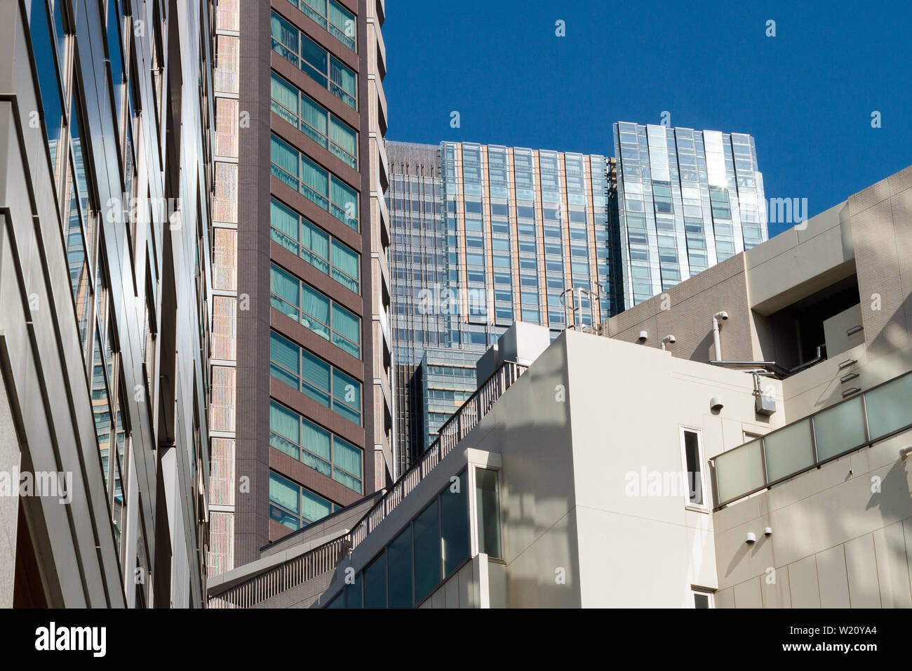 Tokyo Midtown tower seen behind other tall buildings in Roppongi, Tokyo, Japan. Friday February 5th 2016 - Stock Image