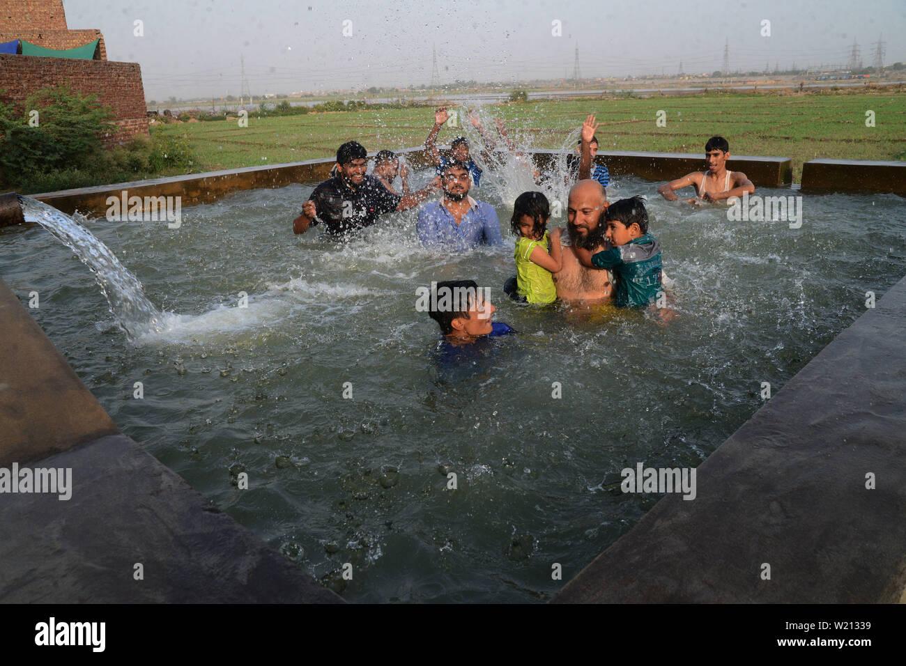 Lahore, Pakistan  01st July, 2019  Pakistani youths cool off