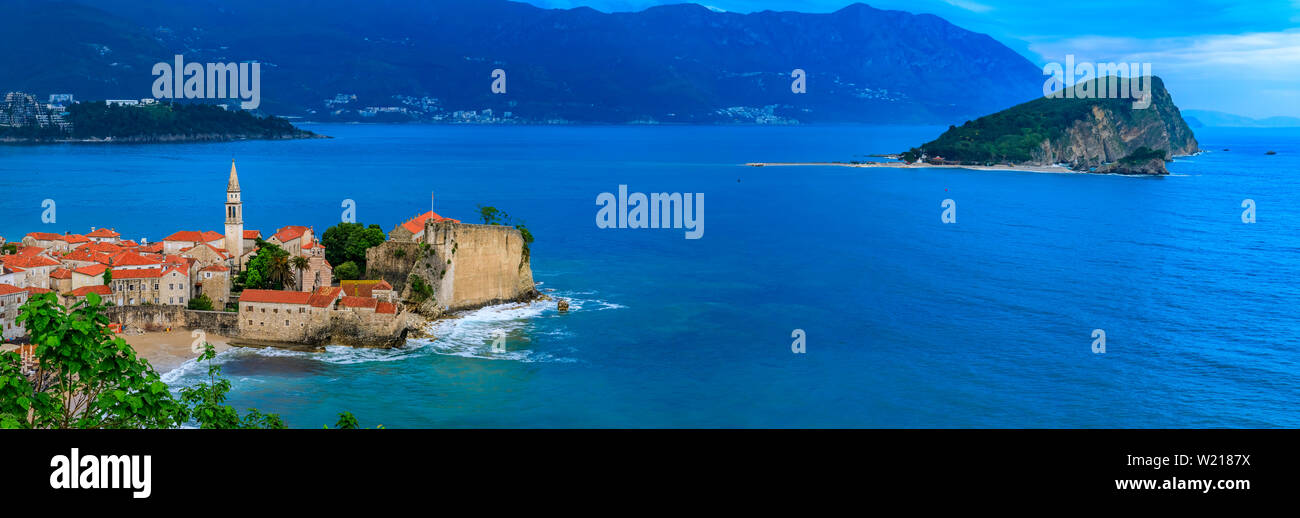Panoramic view of Budva Old Town with the Citadel and the Adriatic Sea in Montenegro on the Balkans at sunset - Stock Image