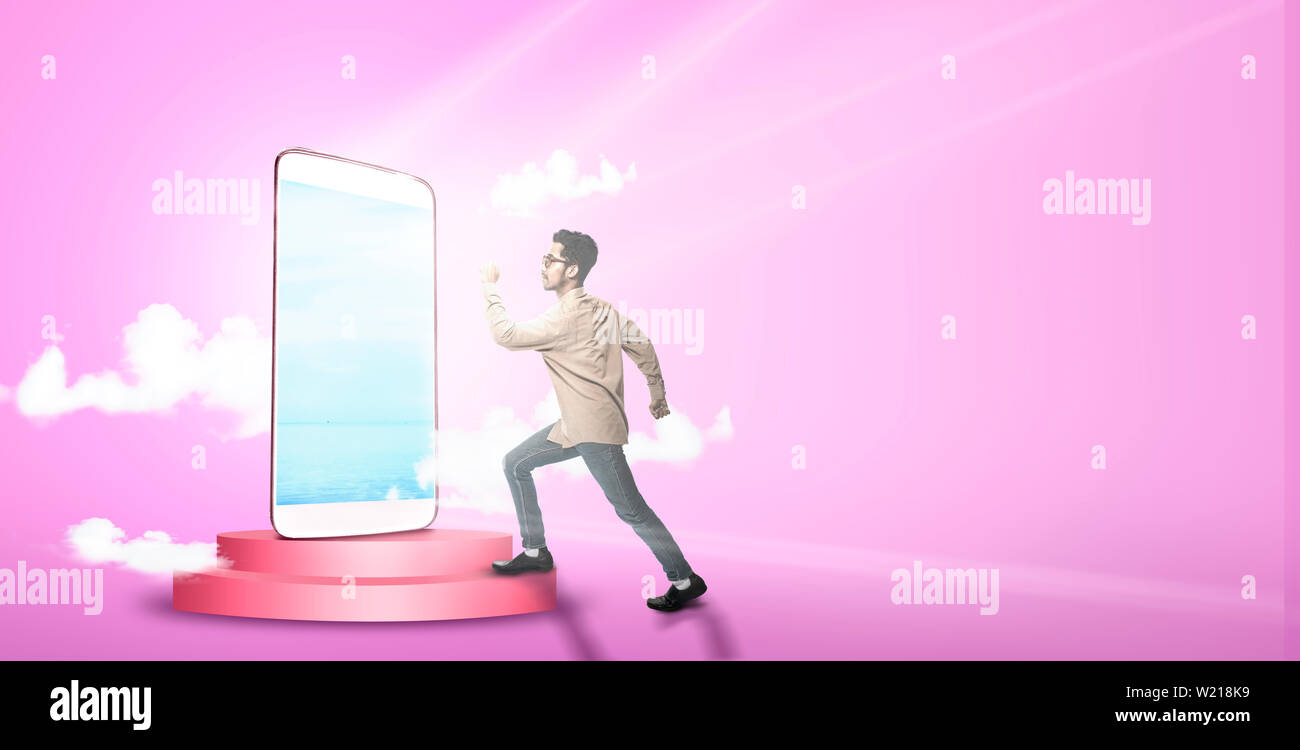 Mobile phone with pink background  Asian man going to the