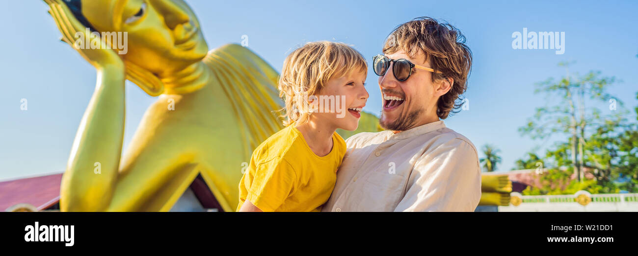 Happy tourists dad and son on background ofLying Buddha statue BANNER, LONG FORMAT Stock Photo