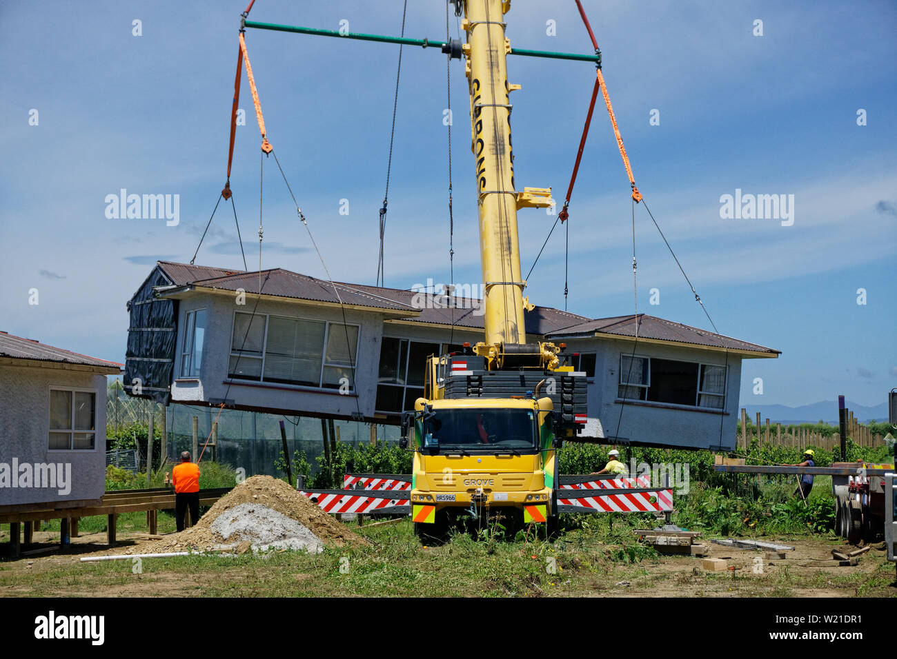 Motueka, Tasman/New Zealand - December 7, 2018: A house that has been sawn in two and moved to its new address being unloaded from a truck. Stock Photo