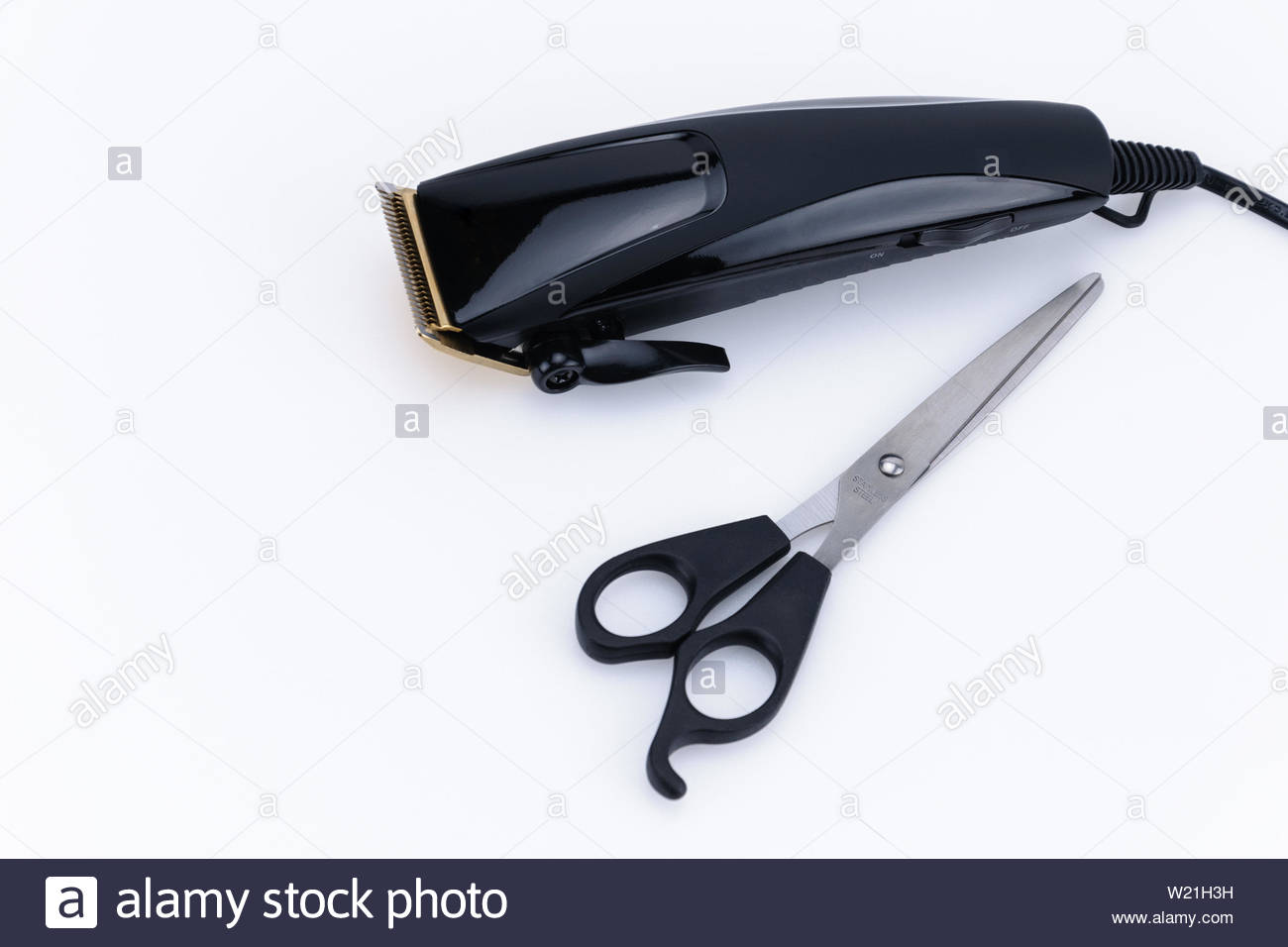Close up of Electric hand-held hair clipper with accessory  for hair salon or barber shop on the white background with copy space - Stock Image