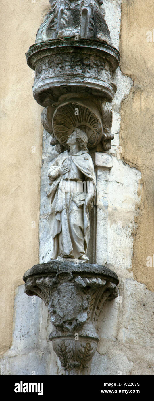Sculpture of a Catholic Saint in Barcelona Stock Photo