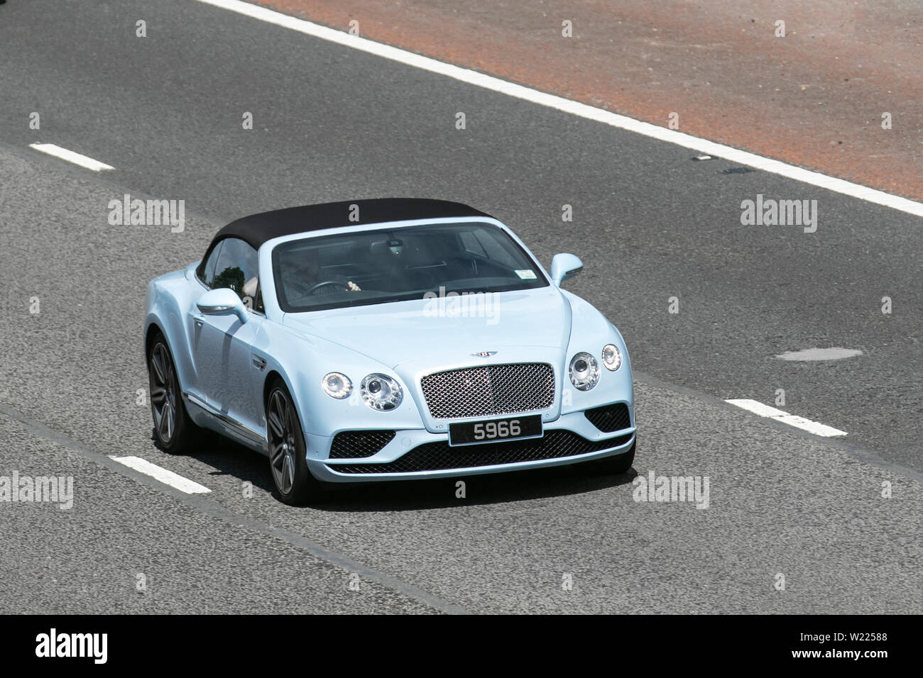 Powder Blue Bentley Convertible M6 Lancaster Uk Vehicular Traffic Transport Modern Saloon Cars With Private Number Plate Personalised Cherished Dateless Dvla Registration Marks Registrations Saloon Cars North Bound On The 3 Lane Highway