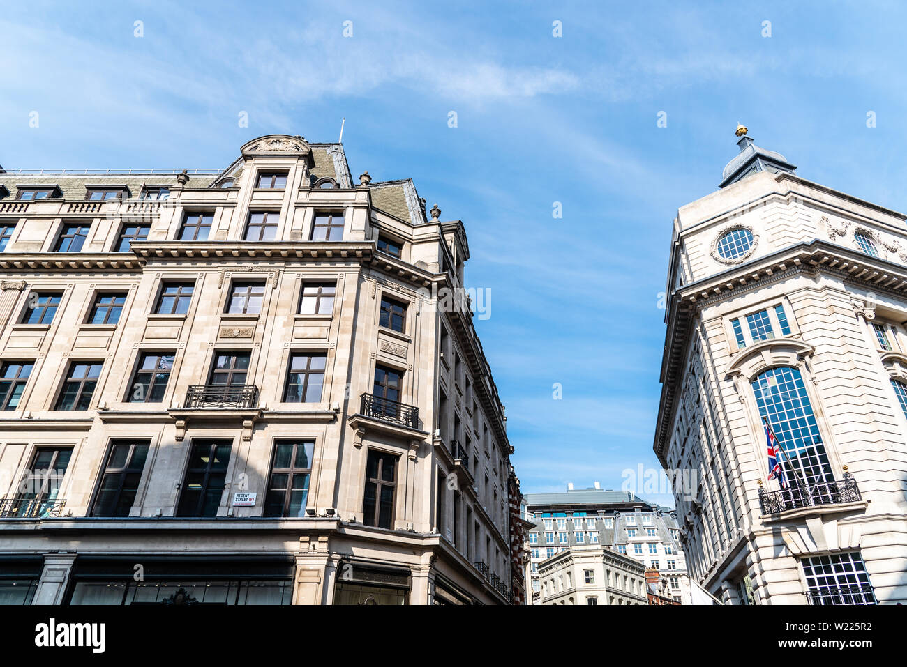 London, UK - May 15, 2019: Low angle view of old buildings in Regent Street in London against blue sky Stock Photo
