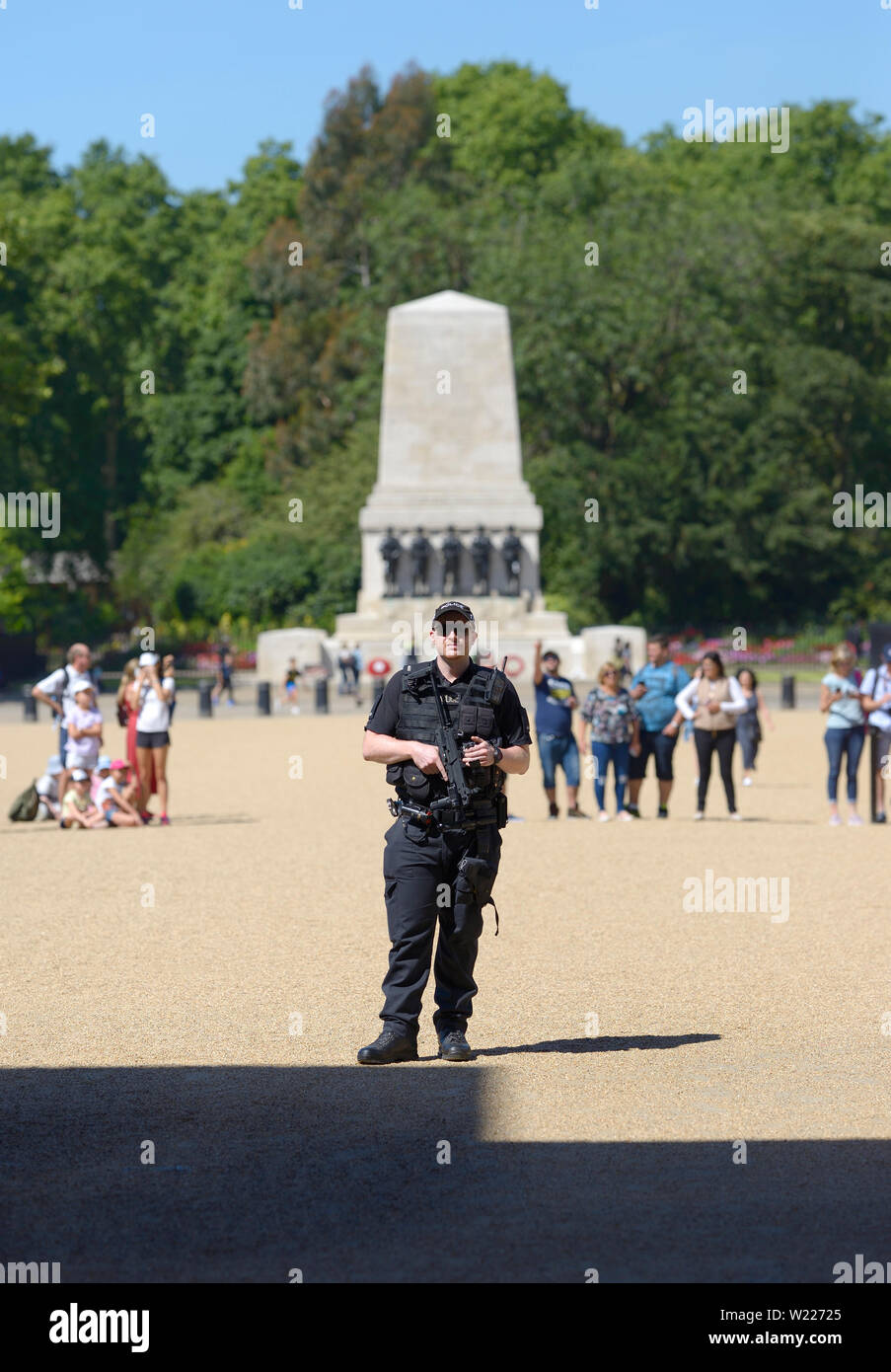 London, England, UK. Armed police officer on duty in Horse Guards Parade, Whitehall Stock Photo