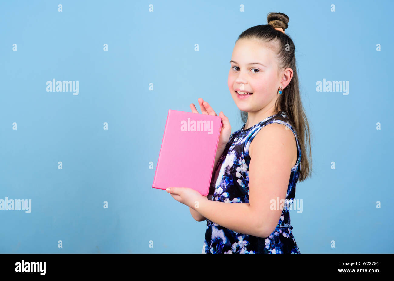 Keeping secrets here. design expert. pr-specialist. small girl with pink note book. school child with notepad. workbooks for writing. school diaries for making notes. Keeping her secrets in diary. - Stock Image