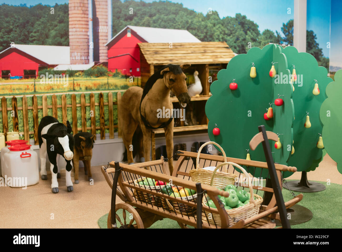 children's toy farm. Toy sheep, pig, cow large on a farm Stock Photo