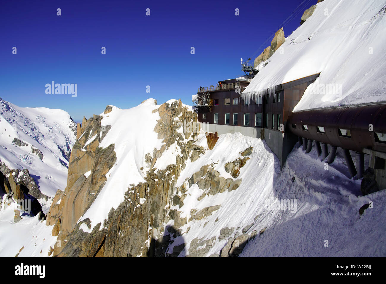 View of Aiguille Du Midi cable car station. Mont Blanc massif in the French Alps above Chamonix. - Stock Image
