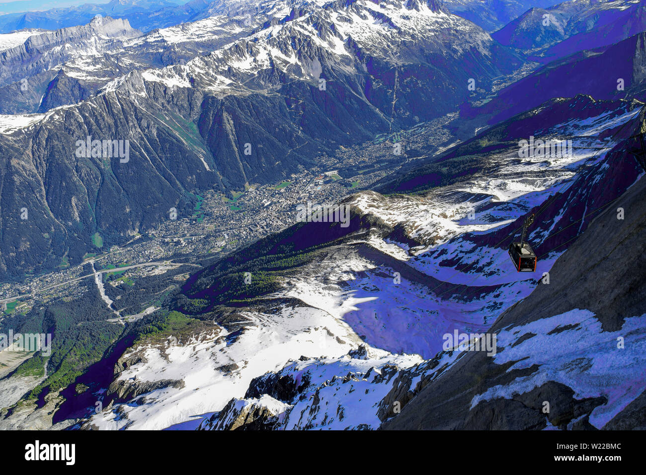 View from Aiguille Du Midi cable car station over Chamonix valley, French Alps above Chamonix. France. - Stock Image